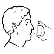 Man holding a metered dose inhaler up to and in front — but not in — his mouth.